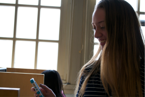 An avid Trivia Crack player. Photo credit to Emma Bally, '17.