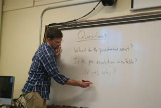 Dr. Noyes leads discussions about The Communist Manifesto in his sophomore seminar class. Photo credit to Emma Bally. '17.